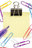 Adhesive paper with colorful paperclips — Stock Photo