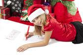 Adorable girl writing letter to santa — Stock Photo