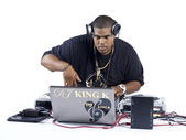 African american dj using a laptop while playing music — Stock Photo