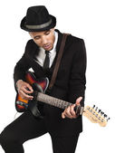 African american young businessman playing guitar — Stock Photo