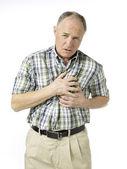 Aged man suffering chess pain — Stock Photo
