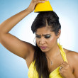 Stock Photo: Irritated womwith party hat