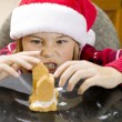 Angry boy making gingerbread house — Stock Photo