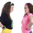 Stock Photo: Angry young females standing face to face