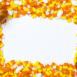 Arrangement of candy corns and pumpkins — Stock Photo #20326685