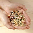 Assorted beans in human hands — Stock Photo