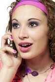 Angled shot of girl on cell phone — Stock Photo