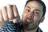 Angry man punching toward the camera — Foto Stock