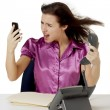 Angry businesswomanswering calls — Stock Photo #20331071
