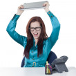 Angry office girl about to throw her laptop — Stock Photo