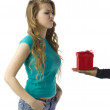 Annoyed woman receiving gift — Stock Photo