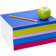 Apple and pencil on top of books — Foto Stock