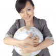 Asian lady hugging globe — Stock Photo #20334311