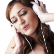 Attractive female listening music — Stock Photo