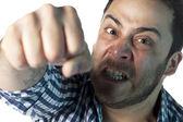 Rozhněvaný muž děrování — Stock fotografie