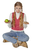 A sad woman thinking what to eat — Stock Photo
