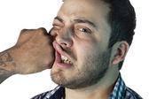 A man being punched in the face — Stock Photo
