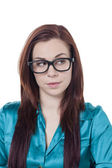 Attractive girl wearing eye glasses in suspicious look — Stock Photo