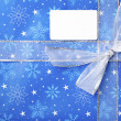 Detailed view of blue christmas box with placard — Stock Photo
