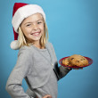 A girl smiling with cookies — Stock Photo