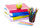 A green apple on school books — Stock Photo