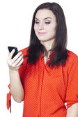 A happy woman reading text message — Stock Photo