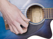 A man strumming guitar — Stock Photo