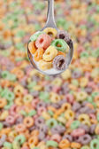 A spoon with colorful cereals — Stock Photo