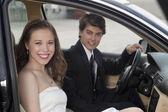 A romantic couple inside the car — Stock Photo