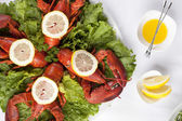 A plate with salad and lobsters — Stock Photo