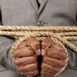 Business hands tied with rope — Stock Photo