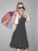 A pretty woman with shopping bags and cellular phone — Stock Photo