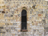 Arch window on stone wall — Stock Photo