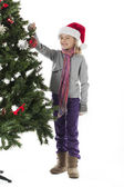 Smiling girl holding christmas bauble — Stock Photo