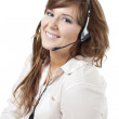 A smiling call center employee — Stock Photo #23811985