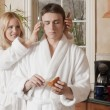 Royalty-Free Stock Photo: A woman giving massage to her husband
