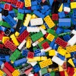Assorted plastic toy bricks - Stock Photo