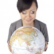 Attractive asian lady with globe in her hand — Stock Photo #23877511