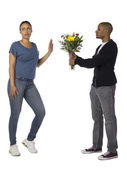 A woman refusing a guy for giving her a flower — Stock Photo