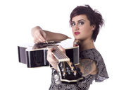 A woman strumming her guitar — Stock Photo
