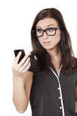 Astonished woman holding cellphone — Stock Photo