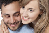 A young couple smiling — Stock Photo