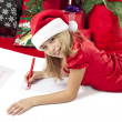 Adorable girl writing letter to santa — Stock Photo #23933063