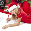 Adorable girl writing letter to santa — Stock Photo