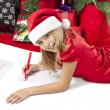 Adorable girl writing letter to santa — Stock Photo #23933063