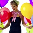 Adult woman holding balloons — Stock Photo