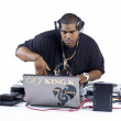 Royalty-Free Stock Photo: African american dj using a laptop while playing music
