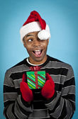 African american man with a christmas gift — Stock Photo