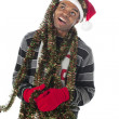 African american man looking away with christmas decorations — Stock Photo