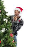 Afro-amerikaanse man met de vinger op de lippen — Stockfoto